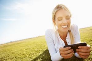 Woman Gambling on Mobile Phone