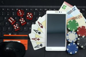 Poker And Dice With iPhone On Keyboard