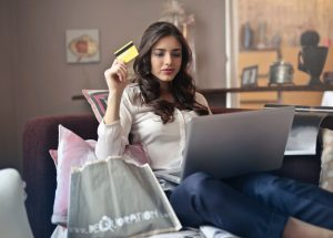 Woman On Laptop And Holding Credit Card